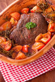 Pot roast with tomatoes and herbs Stock Photos