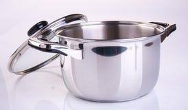 pot of roestvrij staal kokende pot op een achtergrond Royalty-vrije Stock Foto's