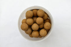 Pot of Round Brown Carp Fishing Boilies Bait  Royalty Free Stock Image