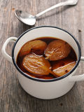 Pot of rustic poached pear Royalty Free Stock Photography