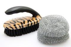 Pot scratch and washing brush Stock Photo