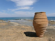 A pot on the seashore Stock Photos