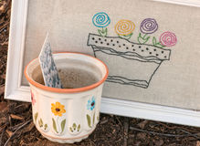 Pot & Seed packet with flowers blooming. Royalty Free Stock Image