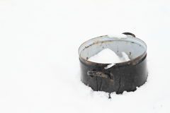 Pot in snow Royalty Free Stock Image