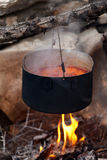 Pot with soup cooking on campfire. Pot with borscht (Ukrainian traditional soup) cooking on campfire Royalty Free Stock Photo