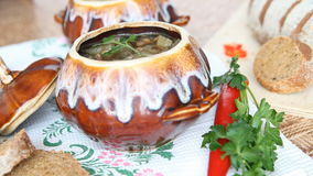 A pot of soup decorated with greens. stock video footage