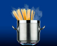 Pot of spaghetti on the stove Stock Images