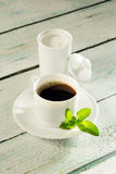 Pot of stevia sweetener and coffee. Coffee cup and a pot of white natural sweetener stevia Royalty Free Stock Images