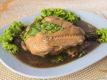 Pot stewed duck with coriander on top.  Stock Image