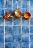 Pot, stewpot, coffee maker hanging on. Hanging retro design copper kitchenware set. Stock Images