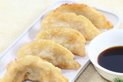 Pot stickers. Or Chinese dumplings with Asian dipping sauce stock image