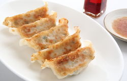 Pot Stickers with Dumpling Sauce and Chili Oil. Baked dumpling Gyoza with minced pork and vegetable stuffing. Gyoza are usually eaten with dipping sauce made at royalty free stock image