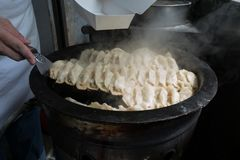 Pot stickers gyoza ,Chinese cuisine, view from the top. Pot Stickers with Dumpling Sauce and Chili Oil. Space, back stock photos
