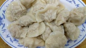 Pot stickers gyoza ,Chinese cuisine, view from the top. Pot Stickers with Dumpling Sauce and Chili Oil. Space, back royalty free stock photo
