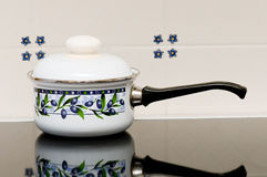 A pot on a stove. A white pot on a stove Stock Photo