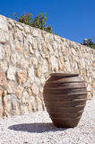 Pot in the sun. Greek looking pot in the sun in front of a brick wall Stock Images