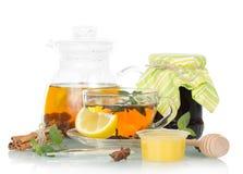 Pot of tea with lemon, honey and jam on white Stock Photos