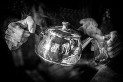 Pot of tea. Serving Turkish tea (Çai) hot and smoking, at a restaurant near Antalya (Turkey Stock Images