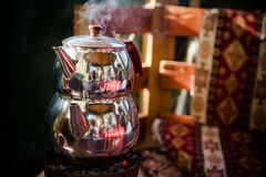 Pot of tea. Pot of Turkish tea (Çai) hot and smoking, at a restaurant near Antalya (Turkey Royalty Free Stock Image