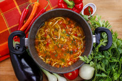 Pot of tomato soup and fresh vegetables Stock Photo