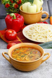 Pot of tomato soup and fresh vegetables Stock Images