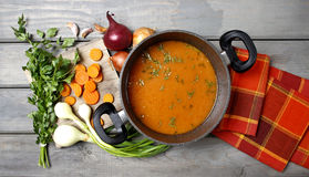 Pot of tomato soup and fresh vegetables Royalty Free Stock Photography