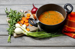Pot of tomato soup and fresh vegetables Stock Image