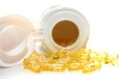 Pot van gele ronde pillen Royalty-vrije Stock Foto's