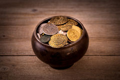 Pot of various coins Stock Image