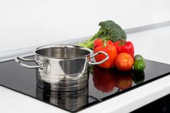 Pot and vegetables in modern kitchen Royalty Free Stock Photo