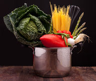 Pot With Vegetables And Spaghetti Stock Images