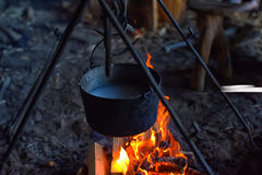 A pot of water on the fire. A pot of boiling water on the fire Stock Image