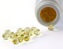 Pot of yellow pills Stock Photography