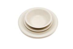 potage beige de soucoupe en plaque du dîner i Photo stock