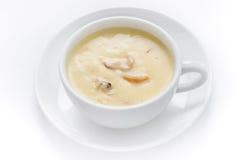 Potage crème avec des champignons de couche Images libres de droits