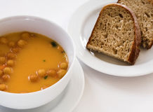 Potage et pain Photographie stock libre de droits