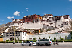 Potala palace with cars in Lhasa, Tibet Stock Photo