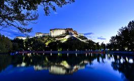 Potala Palace in Tibet. Scenic view of Potala Palace reflecting on lake in foreground, Lhasa, Tibet Royalty Free Stock Images
