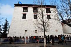 Potala Palace with Pilgrims Stock Photos