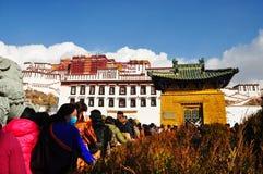 Potala Palace with Pilgrims Royalty Free Stock Image