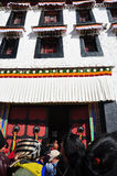 Potala Palace with Pilgrims Royalty Free Stock Photography