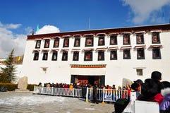 Potala Palace with Pilgrims Stock Image