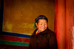 A Potala Palace Woman Devotee smiling in Lhasa Tibet Stock Photo