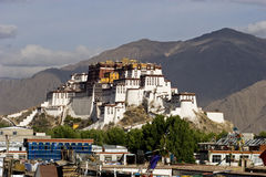 Potala. Palast with Mountains in the Back Stock Images
