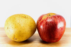 Potapto and apple. Potato and apple good healthy Royalty Free Stock Images