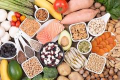 Potassium food sources, top view. Various potassium food sources such as grains, fruit and vegetables, top view stock photo