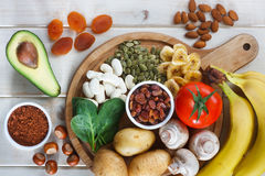 Potassium source in food. Potassium Food Sources on wooden table stock images