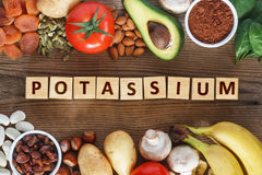 Potassium source in food. Potassium Food Sources on wooden table Stock Image