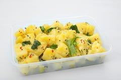 Potat currysjunkande Aloo Royaltyfri Bild