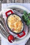 Potatis-blomkål gratäng. Arkivfoton